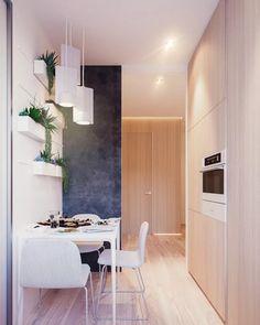 mur ardoise et cuisine dissimulée derriere un placard pour cet appartement minimaliste