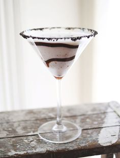 Cookies & Cream Martini | mix two parts Godiva White Chocolate Liqueur, one part vanilla vodka and one part fluffed marshmallow vodka (cake or whipped cream would work too) Don't forget the crushed oreo cookie rim!
