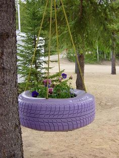 Paint and reuse old tires to make a new planter.