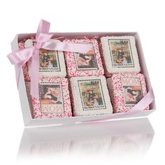 Mother's Day Sugar Stamps?  This gorgeous box will take her breath away! Filled with One Dozen White Chocolate Dipped Stamp Picture Cookies? , our original design incorporates Renoir Masterpieces depicting Mothers. These cookies are as delicious as they are beautiful. A perfect and unique gift for Mother's Day, this White Embossed Clear Top Box will send Mom the message that you care! Contains 12 individually wrapped Picture Cookies resting on a bed of fine tissue paper shred.