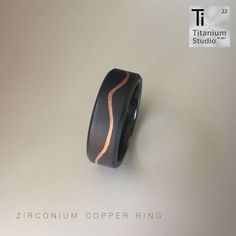 Black Zirconium men's ring with cracked detailing filled with copper. Titanium Rings, Black Men, Wedding Bands, Rings For Men, Copper, Men Rings, Black Man, Brass, Wedding Band