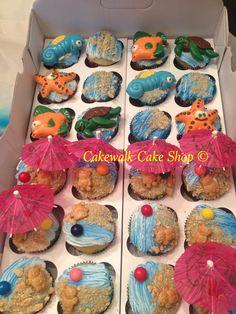 Beach time!! #cakewalkcakeshop #cupcakes #beach #water #umbrella #starfish #seahorse #turtle #fish