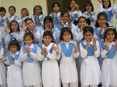 Pakistan girl guides (age 6-11) Junior Guides wear Blue sash with white shalwar qameez, white belt and black shoes.