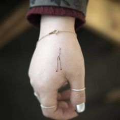 Minimalist Taurus constellation tattoo on the right hand. Tattoo Artist: Sol Tattoo