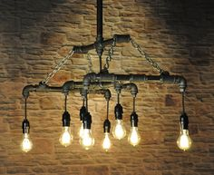 The Menlo Park industrial chandelier light fixture featuring vintage Edison pendant style filament bulbs, black plumbing gas pipe and chains. Our
