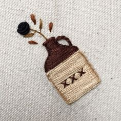 Tiny cup needleworks