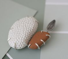 Sterling silver, porcelain and a found terracotta beach pebble brooch made by lilarubyking. $215.00 USD
