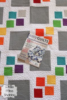 I have been trying for about 2 weeks to get a beautiful outdoor picture of my Gray Square Scramble quilt. It has been traveling along with me, along with my camera everywhere I go in the hopes tha...
