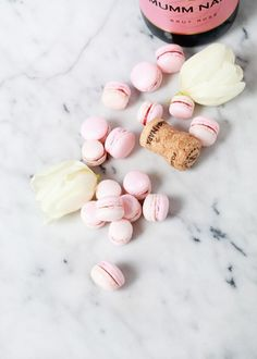 Pretty In Pink Strawberry Rosé Macarons - These gorgeous mini sweet treats are perfect to serve during any celebration such as a bachelorette party or a baby shower party.  - Best Friends For Frosting by Posh Little Designs