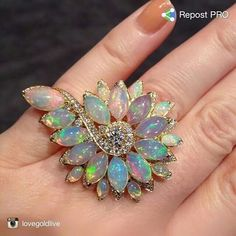 An elegant swirl of opals and diamonds set in gold from @stephenwebsterjewellery
