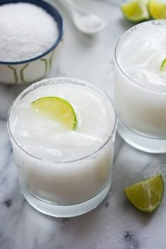 Skinny Coconut Margarita A tropical spin on the classic drink! These Skinny Coconut Margarita are made with lite coconut milk, coconut water, tequila blanco and trip # Refreshing Cocktails, Summer Drinks, Fun Drinks, Sweet Cocktails, Beach Drinks, Summertime Drinks, Party Drinks, Coconut Margarita, Margarita Recipes