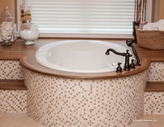 Relax in this soaking tub with classic tile detail! The Birchwood #1239. http://www.dongardner.com/plan_details.aspx?pid=3751. #SoakingTub #MasterBathroom #Bathroom