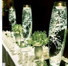 Baby's breath submerged in water with a floating candle! Baby's breath submerged in water with a floating candle! Baby's breath submerged in water with a floating candle! Wedding Bells, Wedding Events, Wedding Reception, Our Wedding, Wedding Flowers, Dream Wedding, Weddings, Wedding Week, Wedding Table