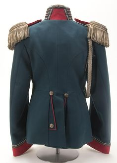 Back side view of an Imperial Russian tunic of a War Ministry Officer acting as Aide de Camp on the Tsar's Staff, circa 1907. Collar and cuffs piped white with silver Litzen. Has a matched pair of silver epaulettes, faced in red, with applied gold Nicholas II crowned ciphers and with silver cord adjutant's aiguillette with silver crowns and points.