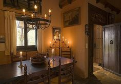 Love the ambiance and structural elements in this Spanish Colonial home