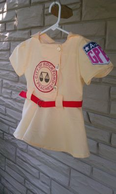12ca5779 Just like the ladies from the Rockford Peaches, your little lady can wear  the dress