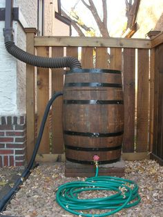 rain barrel. Made from recycled burbon barrel?.... hmmmm :)
