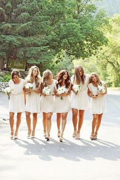 Bridesmaids with flower crowns, and a choice of an updo or long hair that the bride chooses for photos