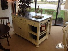 New Arrival!! Pictured here is a Kitchen Island with a stainless steel top that also features a pull out table on wheels and 2 counter height chairs with cushions!!! #HomeFurnitureIN #furniture #kitchen
