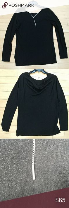 🆕 Michael Kors black & silver sweater long sleeve Black and silver light, weight sweater. The sweater sliver  shimmer to it. The back has a scoop back with a Michael Kors logo silver chain. New and hasn't been worn. MICHAEL Michael Kors Sweaters Cowl & Turtlenecks