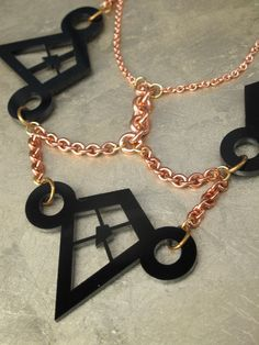 Triangular Made from custom cut acrylic pieces and copper chains. Available in Black, White, or Gold. #GoldChain #GoldJewelry #Necklace #Fashion