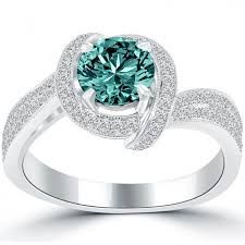 The stunning Vintage style Engagement #ring is centered with an eye catching 1.02ctw Fancy Blue #Diamond. It is set in a unique detailed micro pave setting.  http://jangmijewelry.com/