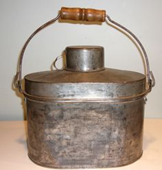Tin lunch pail with its own cup for a top. My grandfather or maybe my greatgrandfather used one of these.