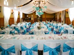 Lachie & Jo - October 2014 - Bright and playful turquoise and coral colour theme, colourful lanterns, bunting and birdcages overflowing with bright flower centrepieces - Mission Estate Winery