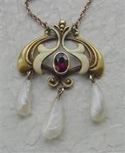 Genuine antique art nouveau pendant with ruby and pearls