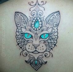 56 cat tattoos that will make you want to get inked: Bright-eyed cat tattoo