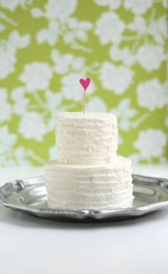 Make a mini anniversary cake. Isn't it cute? Anything tiny is somehow cute. At it's widest, it's 3.5 inches—perfect for 2 people. It tastes like a wedding cake too. You know the wedding cake taste—fruity, decadent, and rich.