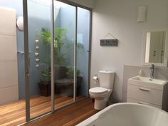 outside shower, wooden bathroom