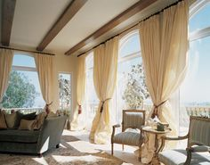 Window+Treatment+Ideas+for+Arch+Windows+-+Drapery+Street