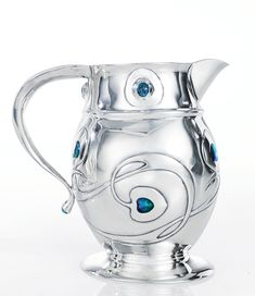 "Archibald Knox A RARE ""CYMRIC"" TANKARD impressed L&Co/CYMRIC and with Birmingham Assay Office marks  silver, turquoise and enamel 1902 produced by Liberty & Co."