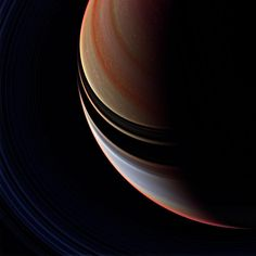 Candy Stripes: This strongly enhanced false color view is a departure from the familiar bluish north and golden south seen in natural color Cassini spacecraft images, but the contrast between regions north and south of the ring shadows is here more readily apparent.