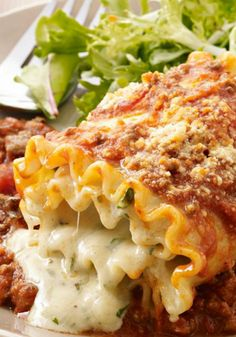 Creamy Lasagna Roll-Ups Recipe ~ Creamy cheese, pasta sauce and ground beef get wrapped up in noodles and baked in this fun take on traditional lasagna.