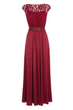 A truly sumptuous maxi gown perfect for any extra special occasion. The Lori Lee Maxi Dress features a sheer bodice lined with a soft slip for a demure and feminine allure. The waist is cinched with a lustrous waist tie embellished with faux gems for an opulent aesthetic. The back of the dress features a graceful keyhole detail and the skirt is fully lined for party perfect movement.