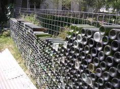 bottle wall by putting bottles in a mesh fencing