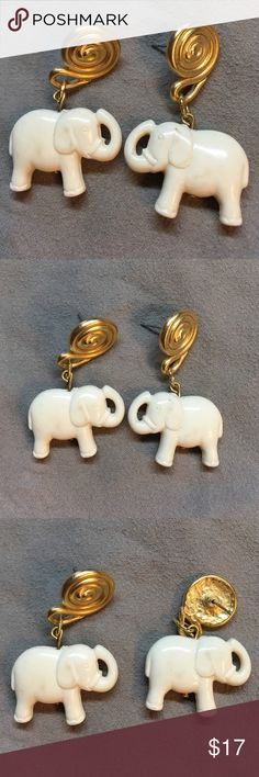 "Elephant Pierced Earrings gold and ivory tone Elephant Pierced Earrings gold and ivory tone. NW. Approximately 1 3/4"" tall x 1"" wide.  Looks like ivory but you know it is some kind of composit. Jewelry Earrings"