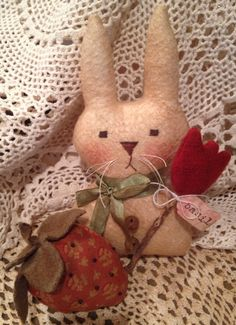 Primitive Easter Spring Bunny Rabbit and strawberry pincushion by Nettiesetsy on Etsy https://www.etsy.com/listing/225439427/primitive-easter-spring-bunny-rabbit-and