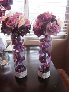 possibly with shorter vases for the bouquets on the Bridal Party table... double use for the bouquets.  could even put battery operated lights in them