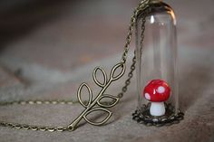 This is a cute, real Lampwork Mushroom necklace in a glass wish orb attached to a antique bronze chain. The lenght is customizable. The necklace will arrieve your home in a cute giftwrap The necklace