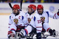 Captain Dmitry Lisov, left, celebrates with his Russian teammates after defeating the USA, 2-1, in their final Group B game at Sochi 2014