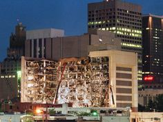 Floodlights illuminate the Albert P. Murrah Federal Building in Oklahoma City April 1995 as rescuers continue searching for bodies in the aftermath of the April 19 explosion caused by a fuel-and fertilizer truck bomb. Texas And Oklahoma, Oklahoma City, Kansas, Downtown Okc, April 19, How To Memorize Things, In This Moment, Building, Federal