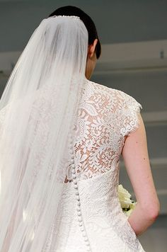 Beautiful lace and buttons. Theia, Fall 2014