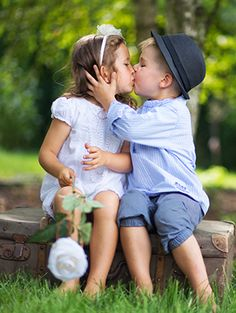 2 little cuties share a summery kiss.