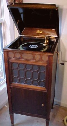 "images antique record players - Google Search    There was one similiar to this left at the farmhouse at Concord.  It had one record on it, ""step it up and go,"" and we played it over and over and over...running to turn the handle on the side as we heard the record voice running down....so much fun!  about 1943-4"