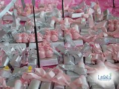 Giveaways Corner for baby Pink and White Themed Baptism Decorations by Leila Events (01027). For orders or further info call or whatsapp +201222220889