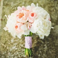 Charming Charleston wedding at Lowndes Grove Plantation with a white and peach color palette and southern details