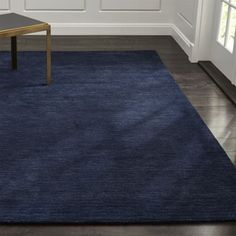 "Shop Baxter Indigo Blue Wool Rug.  A variegated heather effect looms a family of tonals to ground the room in fresh ""solids"" with more interest, more range, more depth and more texture.  Hand-loomed plush New Zealand wool."